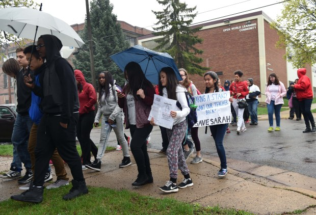 Several dozen students walk out of Open World Learning Community school on St. Paul's West Side Monday, April 25, 2016 to protest a popular teacher at the school not having her contract for next year renewed. (Pioneer Press: Scott Takushi