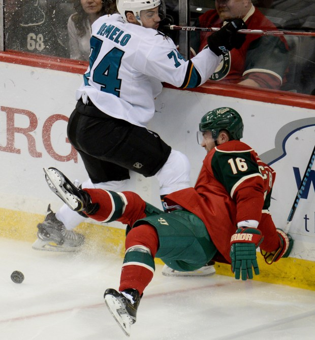 Minnesota Wild left wing Jason Zucker can't keep on his skates as he tries to stop in front of San Jose Sharks defenseman Dylan DeMelo in the third period at Xcel Energy Center in St. Paul on Tuesday, April 5, 2016. The Sharks beat the Wild, 3-0. (Pioneer Press: John Autey)