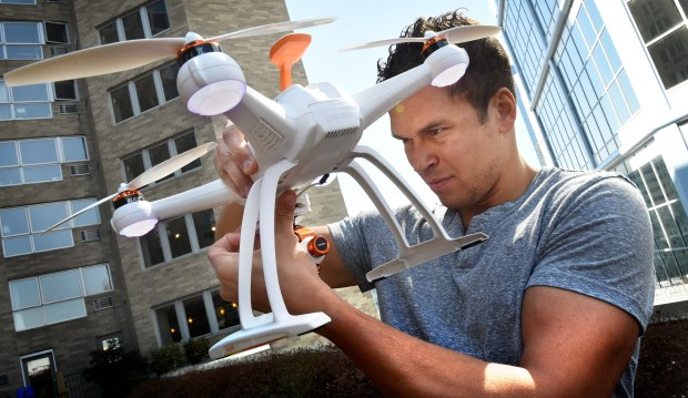 Ryan Hoag, the 2003 Mr. Irrelevant, gets ready to try to fly a Chroma drone on a rooftop patio area outside of his condo in Minneapolis on Wednesday, April 13, 2016. He works for a drone company and travels around the world to film videos for them. This is the 40th anniversary of Mr. Irrelevant, the guy who is taken with the last pick in the draft and goes to Newport Beach, California, in June for a big ceremony and is presented the Lowsman Trophy. He later went on to appear on The Bachelorette in 2008 and Bachelor Pad in 2012, and is now a tennis coach at Washburn High School in Minneapolis. (Pioneer Press: Jean Pieri)