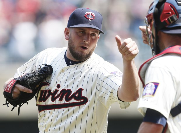 Minnesota Twins pitcher Glen Perkins, left, and catcher Chris Herrmann celebrate the Twins 6-4 win over the Boston Red Sox in a baseball game, Wednesday May 27, 2015, in Minneapolis. Perkins got the save. (AP Photo/Jim Mone)