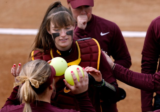 University of Minnesota softball player LeMay Taylor, the team's catcher, is shown in action during a doubleheader sweep of Illinois at Jane Sage Cowles Stadium in Minneapolis on April 9, 2016. Photo courtesy of University of Minnesota Athletics: Eric Miller.