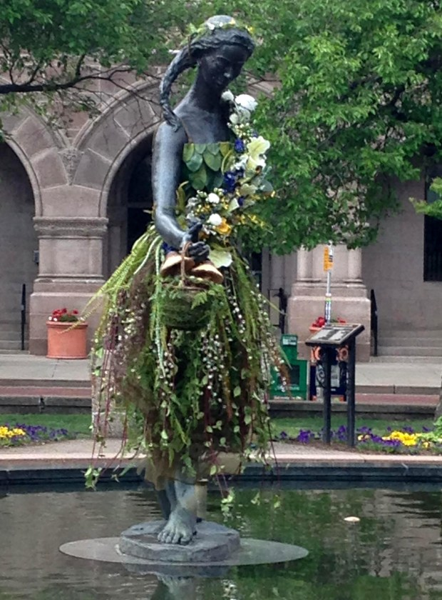"St. Paul Garden Club members Tracy Stutz and Janelle Rasmussen, with help from Rasmussen's daughter Kristin, dressed the ""Little Mermaid"" statue in St. Paul's Rice Park on Thursday, May 19, 2016 to welcome the 600 members of the Garden Club of America visiting the Twin Cities this weekend for the club's annual meeting. Photo courtesy of Sarah Meek."