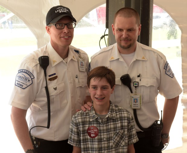 Jack Hamond poses with Lakeview Hospital paramedics, Matthew Lundquist, left, and Nathan Hart, who helped keep him alive after his accident. (Pioneer Press: Scott Takushi)
