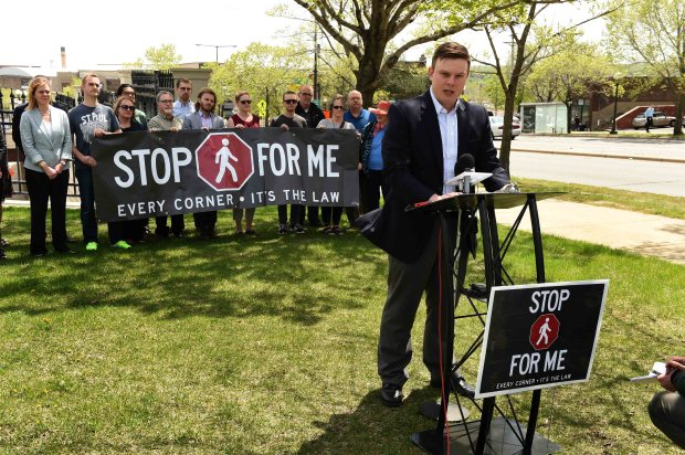 """Kyle Mianulli of Minneapolis spoke at a press conference publicizing the """"Stop For Me"""" movement which seeks to make drivers and pedestrians more aware of crosswalk safety and driving rules, in St. Paul, May 3, 2016. The location is close to where Shelby Kokesch, 24 , was struck by a car in March and later died. (Pioneer Press: Scott Takushi)"""