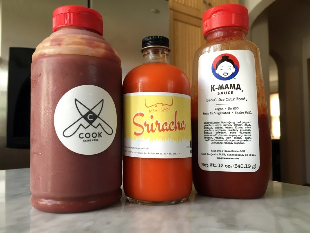 Cook St. Paul's house Korean hot sauce, from left, St. Paul Meat Shop's sriracha sauce and K-Mama's sauce. (Pioneer Press: Jessica Fleming)