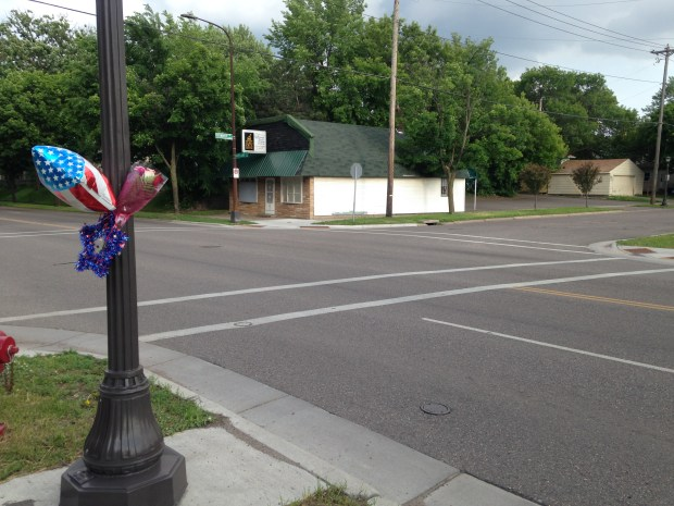 A balloon and flowers are tied to a light post at Maryland Avenue at Greenbrier Street in St. Paul on Sunday, May 29, 2016. Erin Elizabeth Durham, 34, of St. Paul was fatally struck while walking at the intersection Monday. (Pioneer Press: Molly Guthrey)