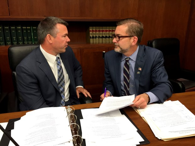 Minnesota Rep. Tim Kelly, R-Red Wing, talks with Sen. Scott Dibble, DFL-Minneapolis, after a meeting of a committee negotiating a transportation funding deal on Wednesday, May 11, 2016. (Pioneer Press: David Montgomery)