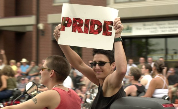 """One of a group of many motorcyclist showed her """"PRIDE"""" as she zoomed down Hennepin Ave in advance of the Ashley Rukes Pride Pararde Sunday morning. On Hennepin at Spruce Place near the end of the 2001 parade route. (Pioneer Press archives)"""