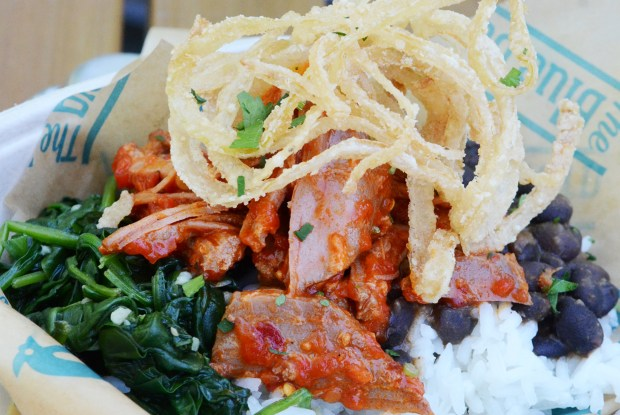 Spicy pork bowl: A mix of adobo pulled pork, rice, black beans, spinach, charred salsa and fried onion strings. At The Blue Barn at West End Market, south of the History & Heritage Center. (Courtesy of Minnesota State Fair)