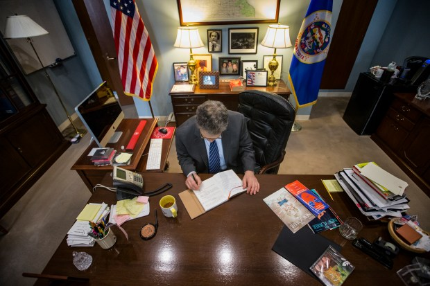 """Sen. Al Franken, D-Minn., writes a message in a condolence book to the people of Orlando following the mass shooting that targeted an LGBT nightclub, on Capitol Hill in Washington, Wednesday, June 15, 2016. For years, Franken has kept one of his most potent political weapons in check: his wit. The former """"Saturday Night Live"""" comic was determined to establish himself as a serious senator after winning his Minnesota seat by a razor-thin margin. So after getting to the Senate in 2009 he embraced the low-key life of a freshman lawmaker. (AP Photo/J. Scott Applewhite)"""