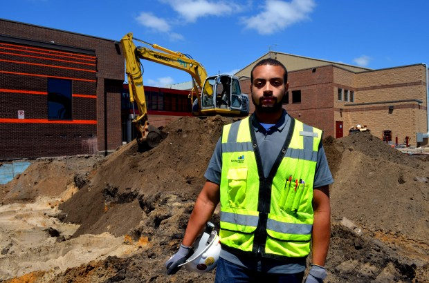 Joe Bjorklund, a construction manager for M. A. Mortenson Co., tours the University of Minnesota's Athletes Village project on the U campus in Minneapolis on Thursday, June 16, 2016. Bjorklund is a former guard on the Minnesota Gophers football team. (Pioneer Press: Andy Greder)