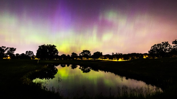 A powerful geomagnetic storm the night of Tuesday, June 23, 2015, allowed stargazers in higher latitudes to witness a show of the northern lights, complete with columns of color and waves of green light. The strength of the storm, photographed here in St. Paul, allowed viewers in the Twin Cities to see the aurora despite the light pollution of the cities, which usually makes viewing of the lights difficult, if not impossible. (Pioneer Press: Andy Rathbun) *Not for file*
