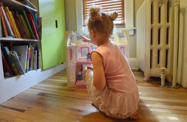 H plays with a doll house in her bedroom of her family's home in St. Paul. The girl and her parents, Dave and Hannah Edwards, made the news earlier this year when they filed a complaint alleging that Nova Classical Academy failed to protect the kindergartner from persistent gender-based bullying and hostility. (Pioneer Press: John Autey)