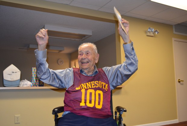"Former Minneapolis Lakers coach John Kundla raises his arms and says, ""I made it!"" during his 100th birthday celebration. He turns 100 on July 3. (Pioneer Press: Andy Greder)"
