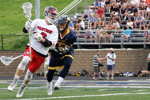 Lakeville North junior Robby Gale works against Prior Lake's Preston Jelen in the first quarter of Prior Lake's 12-5 victory in the state title game on Saturday, June 18, at Chanhassen High School. (Pioneer Press: Jace Frederick)