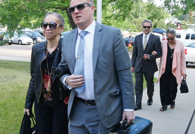 Prince's half-sisters, Norrine Nelson, left, and Sharon Nelson, back right, arrive Monday, June 27, 2016, at the Carver County courthouse in Chaska, Minn. for a hearing over how to verify who qualifies as Prince's heirs. Prince died in April from an accidental painkiller overdose. (AP Photo/Jim Mone)