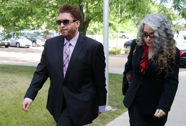 Omarr Baker, the half-brother of Prince, arrives Monday, June 27, 2016, at the Carver County courthouse in Chaska, Minn. for a hearing over how to verify who qualifies as Prince's heirs. Prince died in April from an accidental painkiller overdose. The woman at right is unidentified. (AP Photo/Jim Mone)