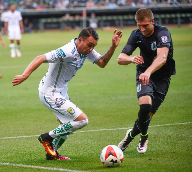 Club Le—n midfielder Miguel Ibarra, left, and Minnesota United FC defender Justin Davisduring battle for the ball the first half of their soccer game at Target Field in Minneapolis on Saturday, June 25, 2016. (Special to the Pioneer Press: Craig Lassig)