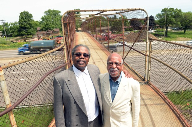 Floyd Smaller, left, and Marvin Anderson stand on a footbridge over Interstate 94 in St. Paul on June 8, 2016. The two are working for community involvement in the design of the I-94 bridges in the former Rondo neighborhood in St. Paul. (Pioneer Press: Scott Takushi)