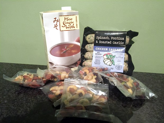 Clockwise from left are mMiso ginger broth, chicken sausages and individual-serving trail mix at Trader Joe''s. (Pioneer Press: Nancy Ngo)