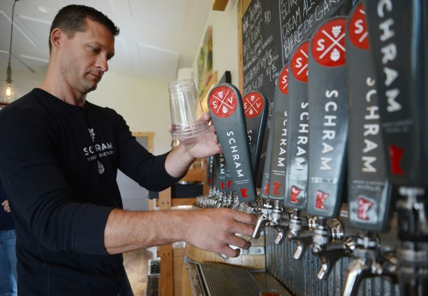 Owner Aaron Schram pours beer for a customer at Schram Vineyards in Waconia on Saturday, April 30, 2016. (Pioneer Press: Holly Peterson)