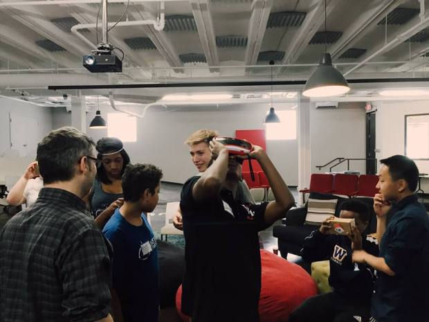 Chuck Olsen of Visual (left) gives teen Silicon North Stars tech campers a crash course in visual reality at CoCo Uptown. (Courtesy photo: CoCo)