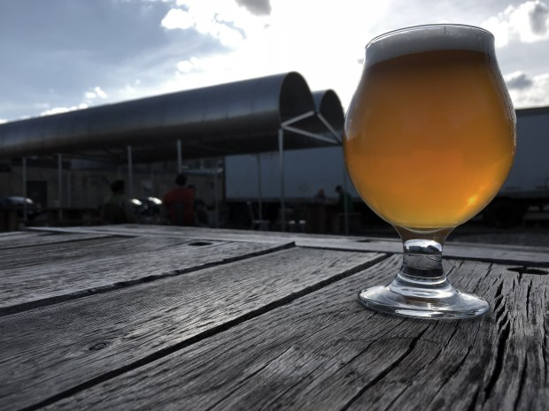 July 19,2016 photo of Club, a beer from Bang Brewing Company, taken on its patio. In the background is the new corrugated steel pergola they added recently to give patrons more outdoor spots to sit and some shade. (Pioneer Press: Jessica Fleming)