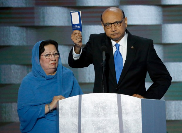 Khizr Khan holds a copy of Constitution of the United States, that he offered to lend to Donald Trump, with his wife Ghazala Khan, during the last day of the Democratic National Convention at the Wells Fargo Center in Philadelphia on Thursday, July 28, 2016. Their son, Humayun S. M. Khan was a University of Virginia graduate who enlisted in the U.S. Army and died serving the United States. (Michael Bryant/Philadelphia Inquirer/TNS)