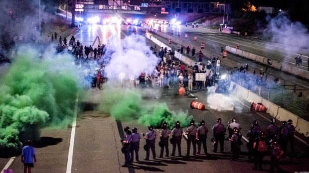 Police use smoke rounds after telling protesters to move off Interstate 94 near the eastbound Dale Street exit in St. Paul just before 10 p.m. Saturday, July 9, 2016. Shortly after, the line of police in riot gear moved back about half a block and continued to tell the protesters to leave. Traffic on the interstate was closed in both directions by a large group protesting the police shooting of Philando Castile, who was killed Wednesday night in Falcon Heights. (Pioneer Press: Andy Rathbun)