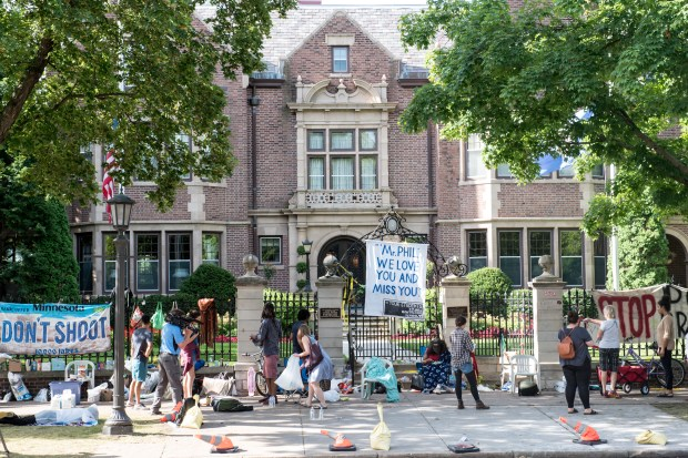 There were about 20 protesters remaining outside the Governor's Residence in St. Paul at about 9 a.m. Tuesday, July 12, 2016. Police early Tuesday removed many of the protesters' items. Dozens, sometimes hundreds, have gathered outside the Summit Avenue mansion in the days following the fatal police shooting of Philando Castile on July 6. (Pioneer Press: Andy Rathbun)