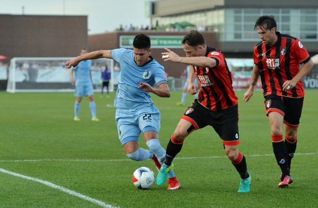 Minnesota United FC defender Kevin Venegas works the ball against AFC Bournemouth midfielder Marc Pugh in the first half of the a Minnesota United FC Friendly Game against AFC Bournemouth from the English Premier League at the National Sports Center stadium in Blaine on Wednesday, 2016. (Pioneer Press: John Autey)