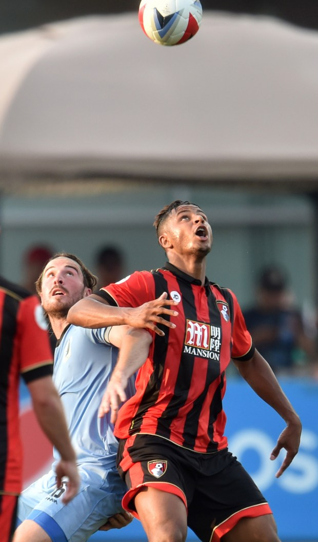 Minnesota United FC defender Brent Kallman, left, and AFC Bournemouth forward Lys Mousset battle for position under the in bound ball in the first half of the a Minnesota United FC Friendly Game against AFC Bournemouth from the English Premier League at the National Sports Center stadium in Blaine on Wednesday, 2016. (Pioneer Press: John Autey)