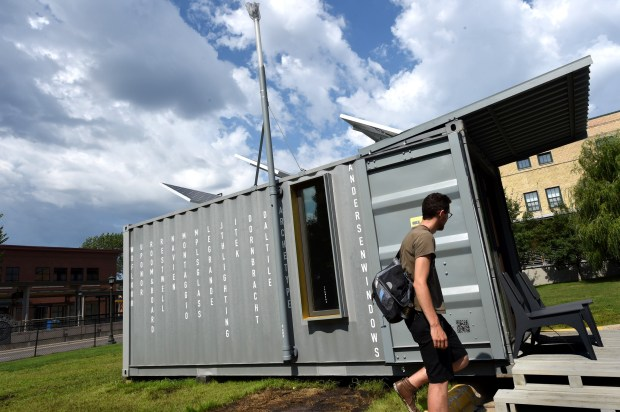 Designer Austin Young shows a tiny house he helped design on Carleton Street in St. Paul Wednesday, July 20, 2016. This house is made of a small steel shipping container that is 8' x 20'. The tiny houses that will be built at Payne and Maryland will be typical wood and drywall. (Pioneer Press: Jean Pieri)