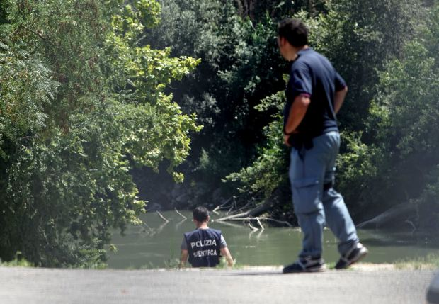 Italian police inspect the banks of the Tiber River in Rome where the body of a young man was found, Monday, July 4, 2016. Italian authorities on Monday were investigating the disappearance of a Wisconsin student in Rome a day after he arrived in the Italian capital. (AP Photo/Andrew Medichini)