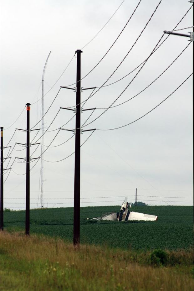 A Worthington, Minn., pilot was killed Friday, Aug. 19, 2016, when his crop-dusting plane hit the guy line of a radio tower in rural Pipestone County. The damaged plane crashed into a soybean field. The tower was also damaged. (Forum News Service)