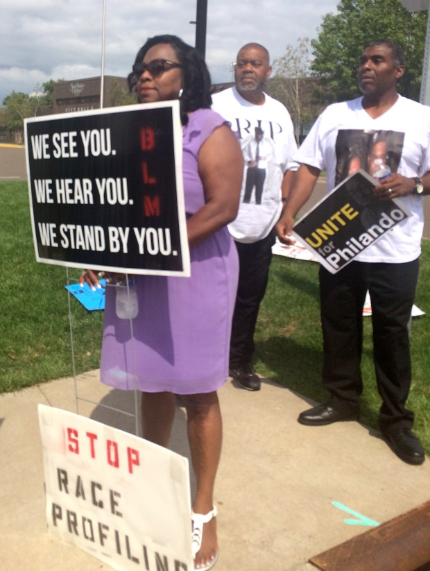 Valerie Castile, the mother of Philando Castile, and two of Castile's uncles, Clarence Castile, left, and Tracy Castile, joined a protest outside St. Anthony City Hall on Friday, Aug. 19, 2016. They and others are upset that St. Anthony Police Officer Jeronimo Yanez, who fatally shot Castile during a traffic stop in Falcon Heights on July 6, 2016, returned to work on Aug. 17, 2016. (Pioneer Press: Mara H. Gottfried)