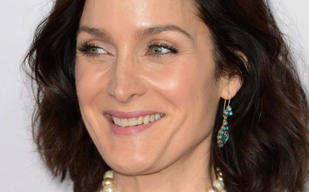 """Actress Carrie-Anne Moss -- """"The Matrix,"""" """"Memento,"""" """"Disturbia"""" -- is 49. She's also in the 2014 film """"Pompeii."""" (Getty Images: Jason Merritt)"""