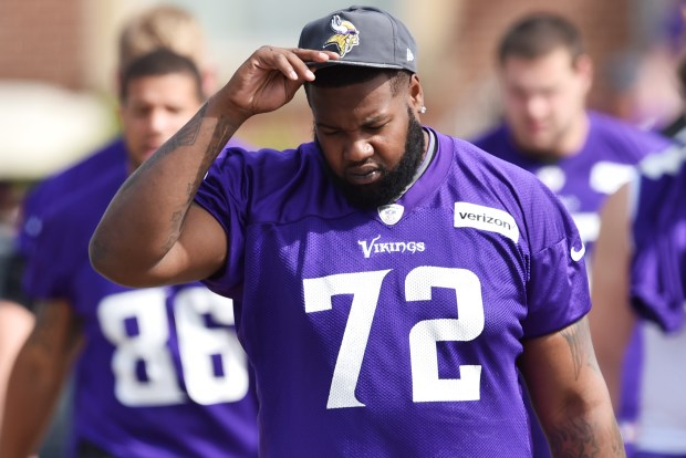 Vikings offensive lineman Andre Smith adjusts his cap as he walks to the morning walk-thru on the second day of the Minnesota Vikings training camp at Minnesota State University in Mankato on Saturday, July 30, 2016. (Pioneer Press: John Autey)