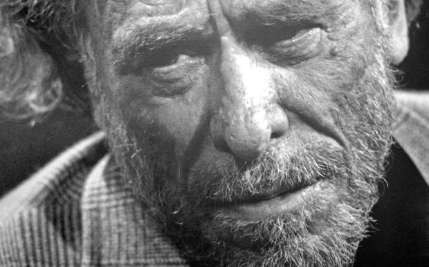 "Poet and novelist Charles Bukowski — the ""laureate of American lowlife,"" as Time magazine wrote — was born on this day in 1920. One of the most original voices in 20th-century American literature, Bukowski lived and wrote at the edge of society. With unflinching honesty and strong language, his poems and tales speak of life on the streets of Los Angeles among the prostitutes, drunks, gamblers, and outcasts struggling to survive in an unforgiving world. He died of cancer in 1994. (Getty Images: Gabriel Bouys)"