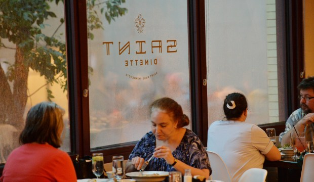 Guests enjoy brunch as they watch the a late morning thunderstorm from the windows of the Saint Dinette in St. Paul's Lowertown district on Saturday, July 23, 2016. (Pioneer Press: John Autey)