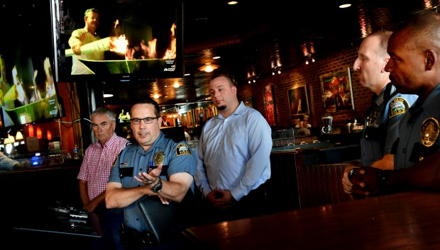 St. Paul Police Federation President Dave Titus speaks at a press conference regarding the strain Summit Avenue protests have put on businesses, residents and police officers at Wild Onion in St. Paul on Thursday, August 4, 2016. Behind him are from left, Mike Schumann, owner of Traditions, Mick Closmore, general manager and partner of Wild Onion, Paul Kuntz, secretary of the St. Paul Police Federation, and Don Benner, director of the St. Paul Police Federation. (Pioneer Press: Jean Pieri)