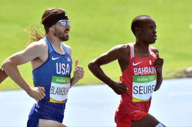United States' Ben Blankenship, left, and Bahrain's Benson Kiplagat Seurei compete in a men's 1500-meter heat during the athletics competitions of the 2016 Summer Olympics at the Olympic stadium in Rio de Janeiro, Brazil, Tuesday, Aug. 16, 2016. (AP Photo/Martin Meissner)