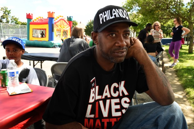 """""""Your voice will not go unheard as long as I have breath,"""" wrote John Thompson on a poster, as a fundraiser was held at Central High School in St. Paul for Philando Castile, Sunday, August 21, 2016. Thompson was a co-worker and friend of Castile for nine years at Central High School. (Pioneer Press: Scott Takushi)"""