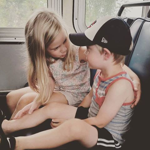 """The Permanent Grandchildrenly Record ... SOUPY of White Bear Township writes: """"This is Shelby, 6, and Paden, 3, my sweet grandkids, on a bus to the Minnesota State Fair. Shelby is telling Paden what to expect on this fun day. She did not steer him wrong. They had a wonderful time."""""""