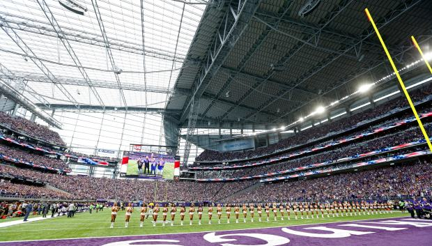 Minnesota Vikings cheerleaders line up on the field at U.S. Bank Stadium before the Aug. 28, 2016, preseason game against the San Diego Chargers. The Vikings will host the Green Bay Packers in the first regular season game in the new stadium Sunday, Sept. 18. (AP Photo/Jim Mone,File)
