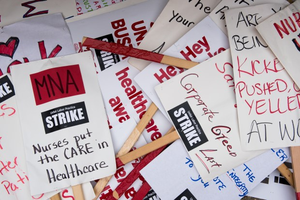 A pile of signs being used by strikers sits near the picket line at United Hospital in St. Paul on Monday, Sept. 12, 2016. (Pioneer Press: Andy Rathbun)