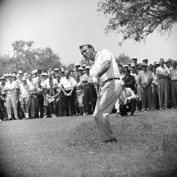 This April 29, 1962, file photo shows Arnold Palmer, lifting an iron shot from No. 5 fairway in the final round of the Texas Open in San Antonio. (AP Photo/Ted Powers)