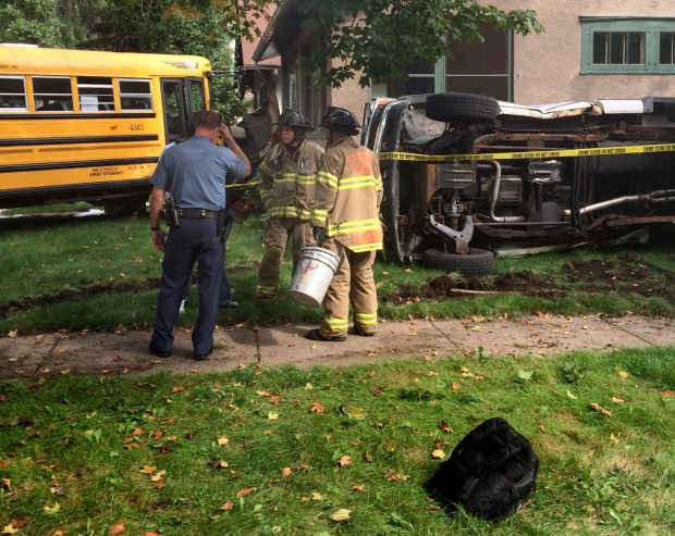 A school bus and pickup truck collided in St. Paul on the afternoon of Friday, Sept. 9, 2016. The bus then crashed into a house. Students had minor injuries, according to police. (Courtesy St. Paul Police)