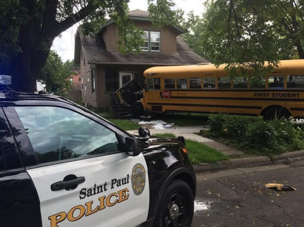 After a pick-up truck struck a school bus in St. Paul, the bus crashed into a house. (Courtesy St. Paul police)