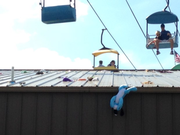 Stuffed animals, money, clothing and a toilet plunger have been dropped on the Little Farm Hands building during the fair. (Richard Chin)